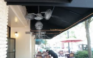 cooling system inside restaurant with fan and mist