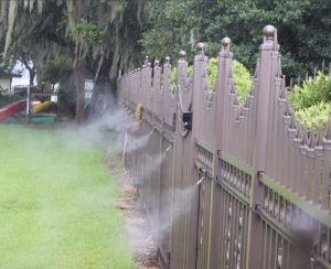 mosquito misting on a fence